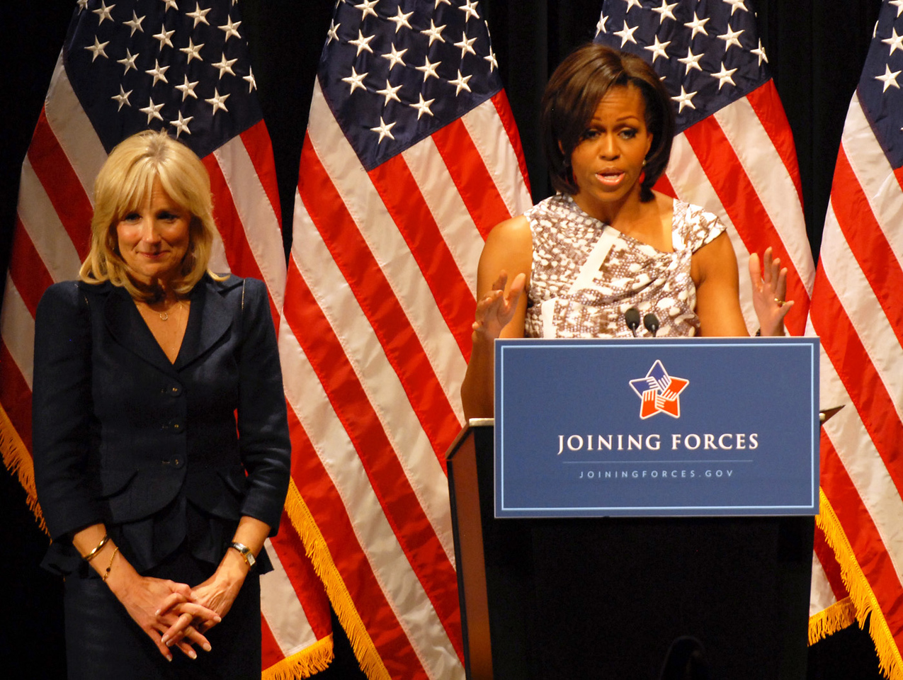 "First Lady Michelle Obama speaks about the White House's ""Joining Forces"" <br /> military family support campaign to a crowd of National Guard and local <br /> families as Dr. Jill Biden stands by during a ""Joining Forces"" community event <br /> in Columbus, Ohio, April 14, 2011. The event was the final stop on Obama and <br /> Biden's two-day tour around the nation to spotlight communities doing <br /> outstanding work to support military families. (Defense Department photo by <br /> Elaine Sanchez)"