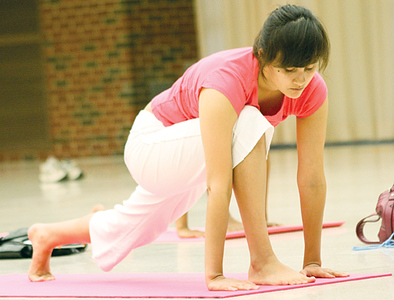 Mino Nadine, practicing yoga at Free yoga workshop organized by HASC, ISA and ASC in RSC Ballroom on Sunday August 29.