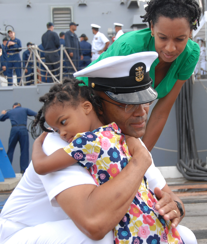 100709-N-0464S-010<br /> PEARL HARBOR (July 9, 2010) Command Master Chief John Hall, assigned to the guided-missile destroyer USS O'Kane (DDG 77), says his goodbyes to his family before the ship departs for a seven-month deployment. O'Kane is scheduled to conduct operations in the Middle East and western Pacific. (U.S. Navy photo by Seaman Rachel Swiatnicki/Released)