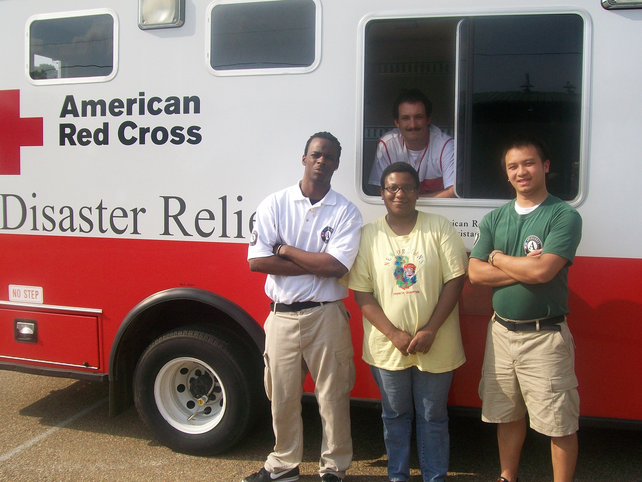 NCCC Corps Member Michael Brown, displaced resident Frelicia May, NCCC Team Leader Moses Moua and ARC Shelter Manager Clifford Boyer.