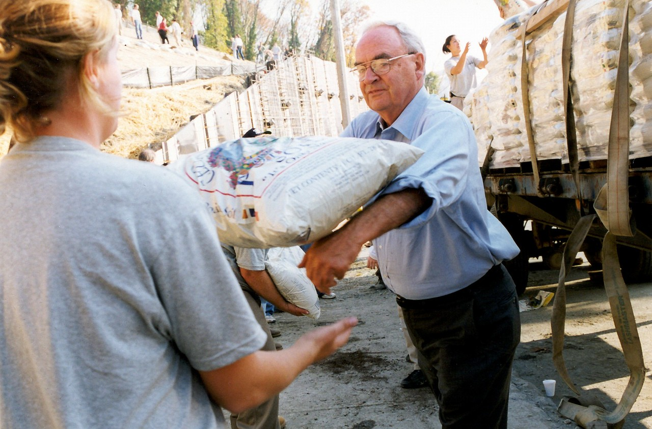 Harris Wofford participates in a flood prevention project.