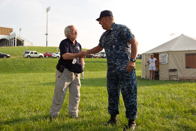 AmeriCorps St. Louis Emergency Response Team Executive Director Bruce Bailey meets with a member of the U.S. Navy in Joplin, MO to volunteer. (Photo by Scott Julian, 2011)