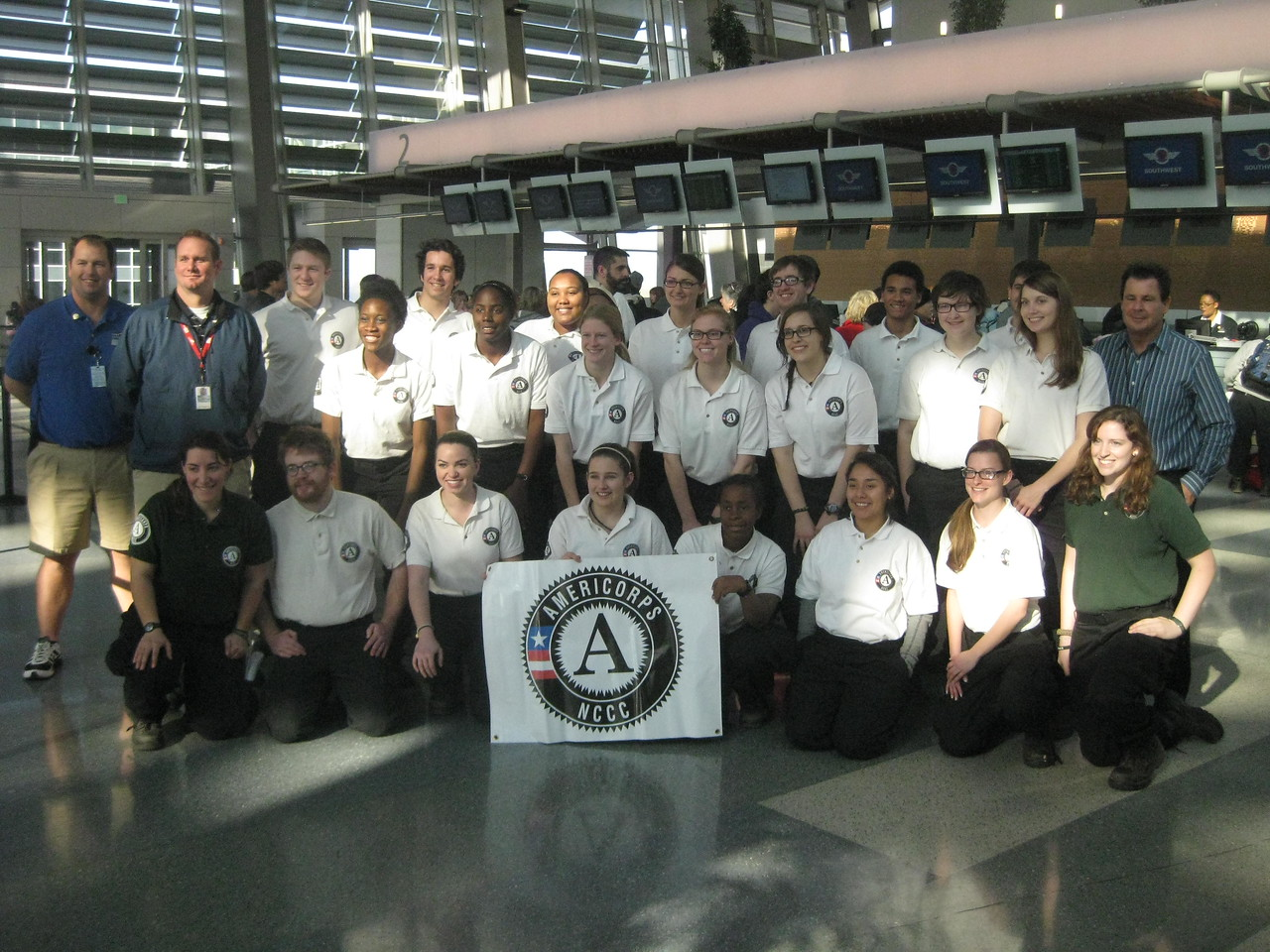AmeriCorps members prepare to board planes from Sacramento, CA, to New Jersey and New York, where they help will rebuild homes and operate volunteer centers.