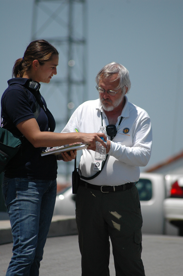 AmeriCorps member Abby Simons, left, and Bruce Bailey, Executive Director of AmeriCorps St. Louis, in Joplin, MO.