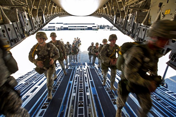U.S. Army paratroopers assigned to the 82nd Airborne Division load onto a C-17 Globermaster III during Large Package Week that happens in conjunction with Joint Operational Access Exercise in Fort Bragg, NC, Oct. 11, 2012. The exercise utilizes several Air Force aircraft to strategically airdrop troops and cargo. (U.S. Army photo)