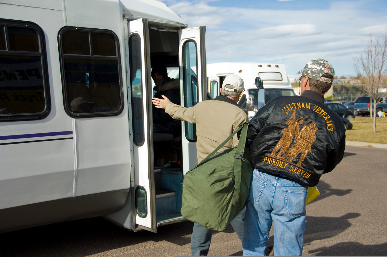 A homeless veteran, now equipped with new items courtesy of the 18th Annual Homeless Veterans Stand Down, gets ready to board a bus at the Denver Armory, Colorado Army National Guard, in Denver, Colo., Nov. 6, 2008,  to return to a homeless shelter. Homeless veterans received services such as new clothes, glasses, shoes, free flu shots, hearing aide repair and a hot meal. (U.S. Army photo by Staff Sgt. Liesl Marelli/Released)