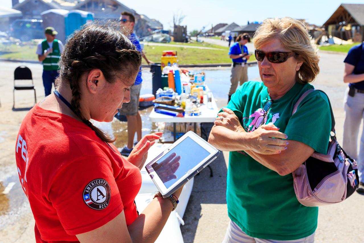 DSAT Worker Talks to Survivor