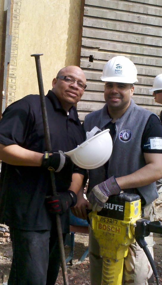 Ronald Moulden and Koby Langley pause for a photo during a VetCorps project in Baltimore.