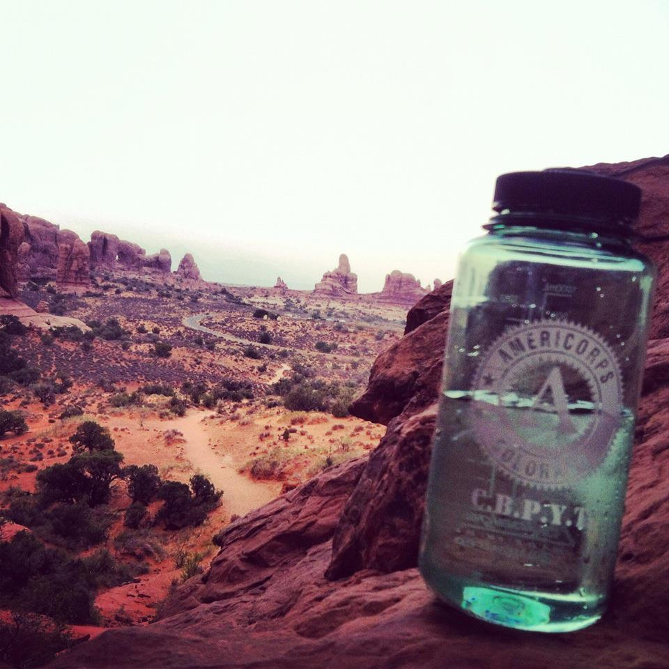 This scenic view shows the rock formations behind an AmeriCorps water bottle from the program Community Building Partnerships for Youth in Transition.
