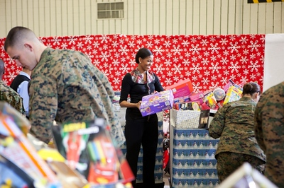 First Lady Michelle Obama sorts toys after she delivers toys and gifts donated by White House staff to the Marine Corps' Toys for Tots Campaign at Joint Base Anacostia-Bolling, Washington, D.C., Dec. 16, 2011. (Official White House Photo by Chuck Kennedy)