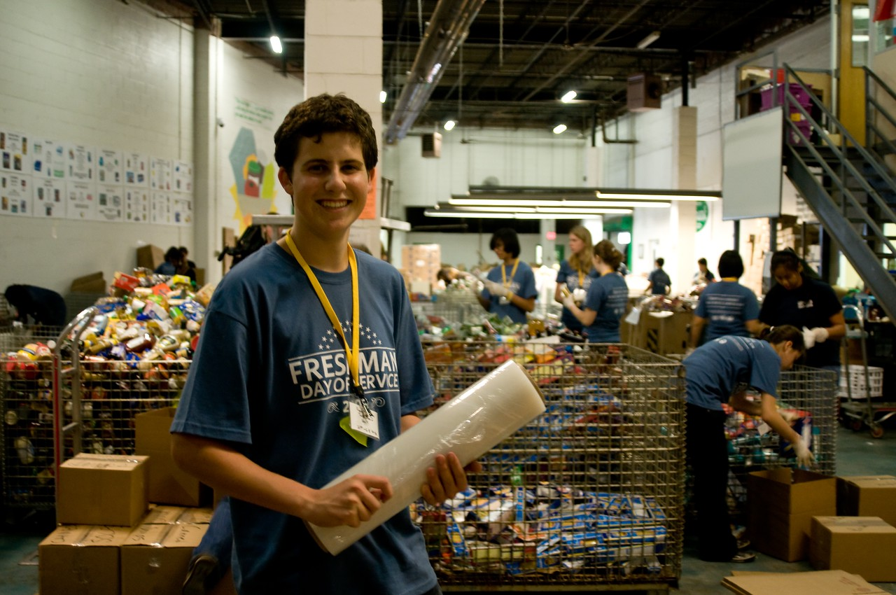 A George Washington University student participates in the school's Freshman Day of Service at the Capital Area Food Bank. Each year, the day is timed to coincide with the September 11 National Day of Service and engages the entire incoming freshman class in service projects throughout the Washington DC area.