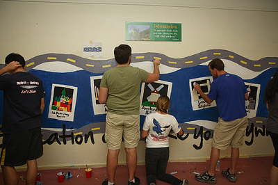 Volunteers  work on a mural-painting project at Belmont High School with City Year LA during the Martin Luther King Day of Service on Jan. 21, 2013.