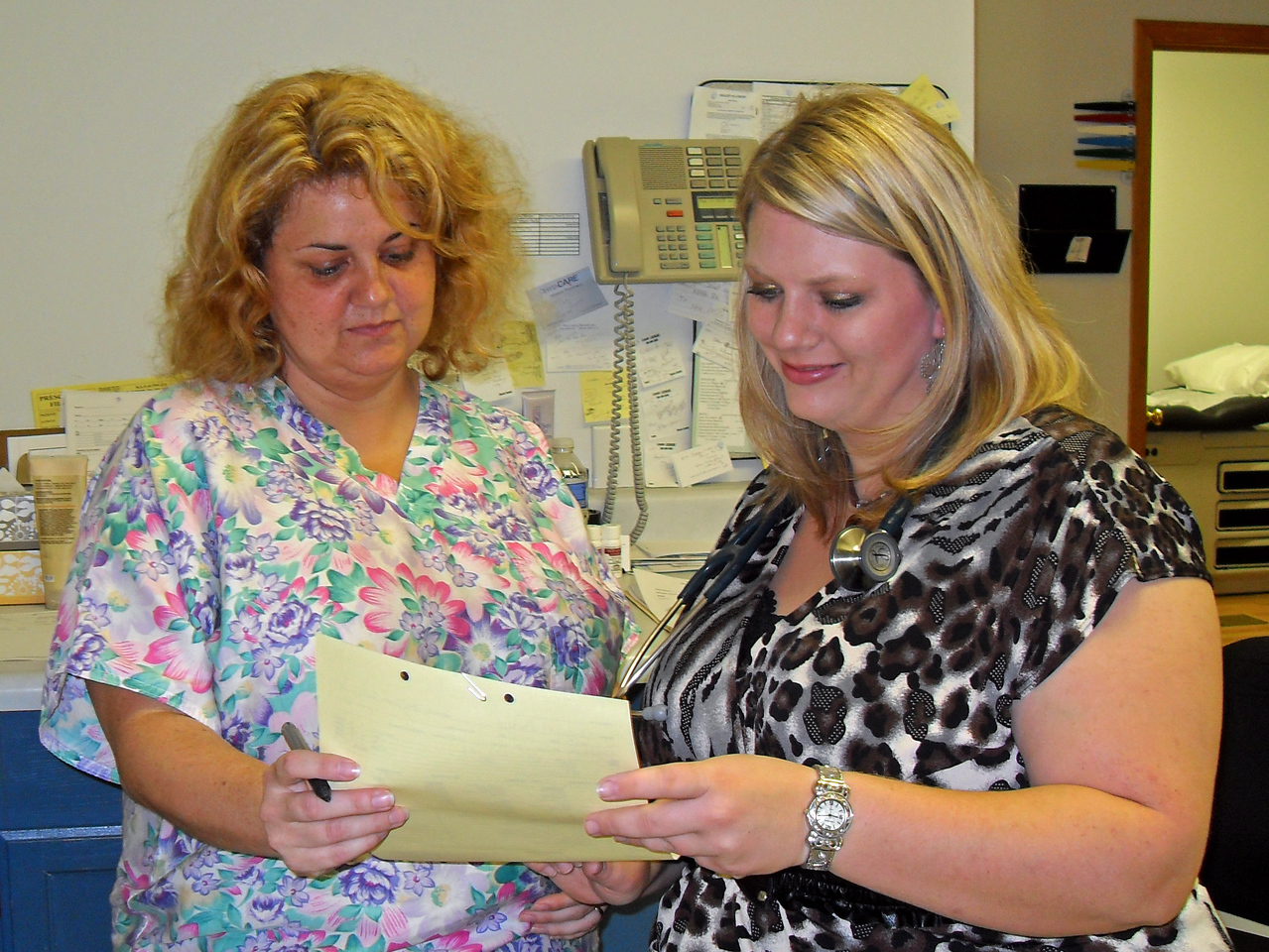 Nurses at the Cumberland Family Medical Center look at a patient's chart. The Cumberland Family Medical Center is a Social Innovation Fund subgrantee of the Foundation for a Healthy Kentucky.