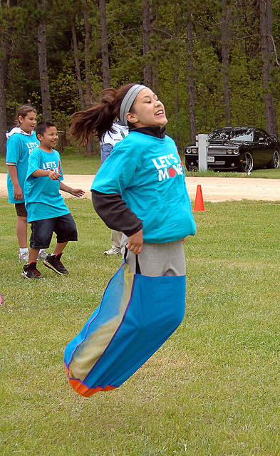 Participants race in the Let's Move in Indian Country launch in Keshena, Wisconsin in May 2011. (Photo by Office of Public Affairs-Indian Affairs.)