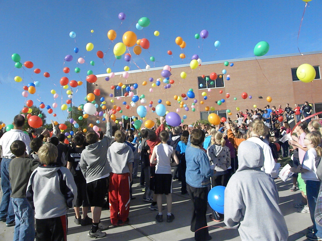 Freeman Public Schools students release balloons after making their pledge against bullying.
