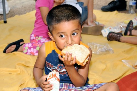 A child enjoys a snack courtesy of CitySquare's Nurture Knowledge and Nutrition program in Dallas, TX. (Photo courtesy of CitySquare)