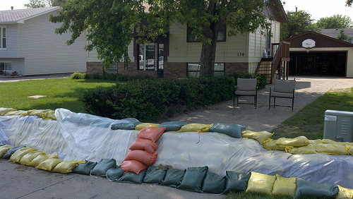Orange sandbag steps to protect dike's plastic barrier in North Sioux City, SD. (Photo courtesy USDA-NRCS, 2011)