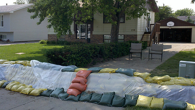 Orange sandbag steps to protect dike's plastic barrier in North Sioux City, SD. (Photo courtesy USDA-NRCS, 2011)