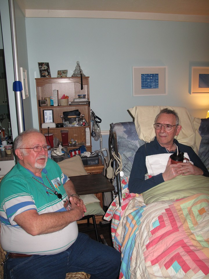 Senior Companion Larry Mills sits with a fellow veteran at the Salt Lake City Veterans Administration Medical Center.