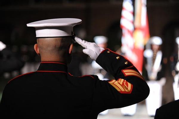 A U.S. Marine Corps staff sergeant salutes the colors at the center walk during the Evening Parade at Marine Barracks Washington in Washington, D.C., May 13, 2011. A parade is held at the barracks every Friday during the summer months. (U.S. Marine Corps photo by Lance Cpl. Cody A. Fodale/Released)