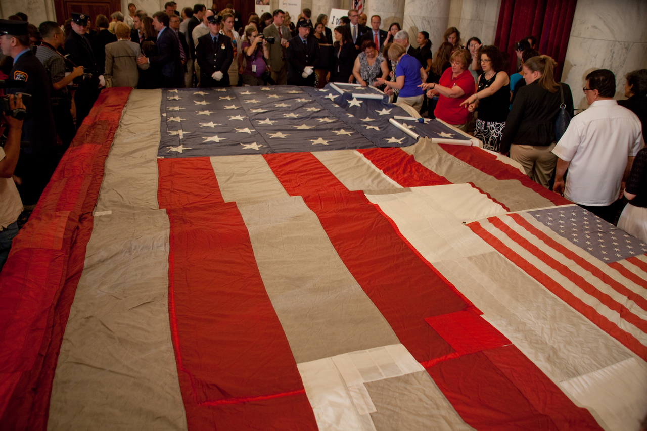 Onlookers view the National 9/11 Flag on display during its stop in Washington DC on July 14, 2011.