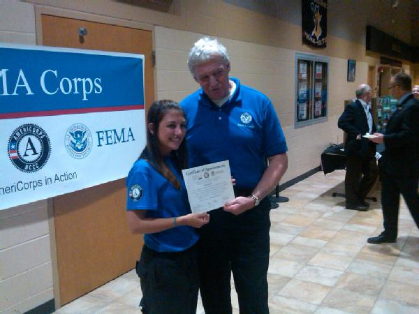 FEMA Deputy Administrator Rich Serino stops for a photo with Amelia Rubin, a member of the inaugural FEMA Corps class who spoke during the September 2012 induction ceremony in Vinton, IA.