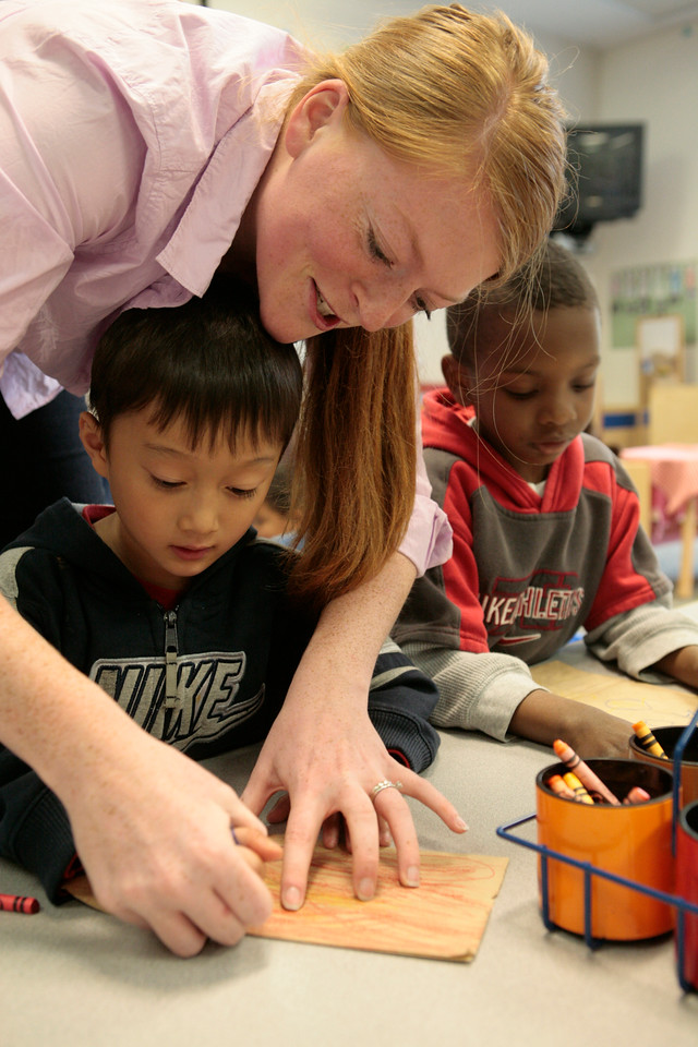 Seattle University student Rebekah Rogalsky works with students at Madrona Elementary school in this 2010 photo. (Photo by Chris Taylor)