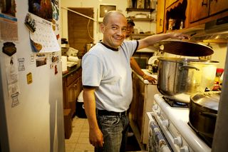 Jorge Munoz of An Angel in Queens works in the kitchen where he makes meals to distribute to homeless day laborers in New York City.