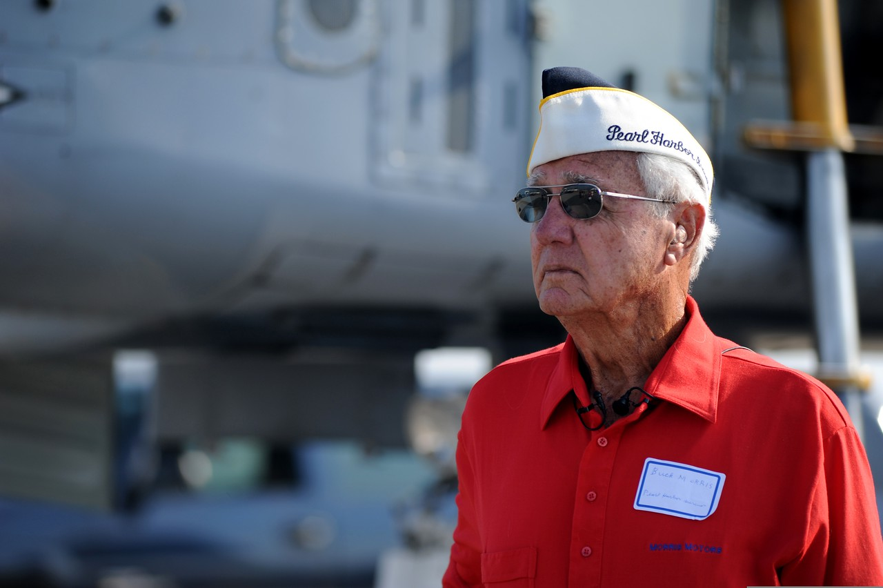 Buck Morris, a U.S. Navy veteran and a survivor of the attack on Pearl Harbor, prepares for an interview during the 2011 Charleston Air Expo at Joint Base Charleston, S.C., April 9, 2011. The expo was attended by more than 80,000 spectators and featured the Army Special Operations Black Daggers, Air Force Thunderbirds, GEICO Skytypers, and a re-enactment of the 1941 attacked on Pearl Harbor performed by the Tora! Tora! Tora! demonstration team. (U.S. Air Force photo by Staff Sgt. Nicole Mickle/Released)