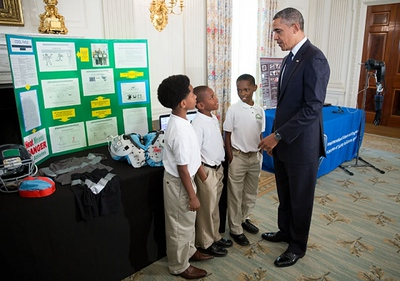 President Barack Obama talks with Evan Jackson, 10, Alec Jackson, 8, and Caleb Robinson, 8, from McDonough, GA, while looking at exhibits at the White House Science Fair in the State Dining Room, April 22, 2013. The sports-loving grade-schoolers created a new product concept to keep athletes cool and helps players maintain safe body temperatures on the field. (Official White House Photo by Chuck Kennedy)