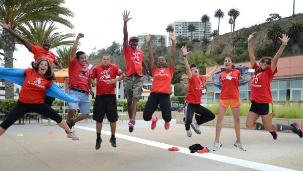 Southern California Playworks AmeriCorps coaches jump to make an impact for more than 14,000 kids in the region. (Photo by Southern California Playworks)