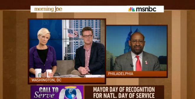 Philadelphia Mayor Michael Nutter (right) discusses the Mayors Day of Recognition for National Service with MSNBC's Morning Joe hosts Mika Brzezinski (left) and Joe Scarborough (center) on April, 9, 2013.