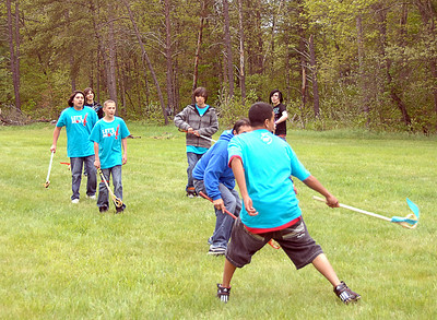 Participants play a game of lacrosse at the Let's Move in Indian Country launch in Keshena, Wisconsin in May 2011. (Photo by Office of Public Affairs-Indian Affairs.)
