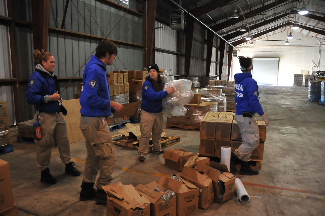 A FEMA Corps team detailed to FEMA Logistics helps sort ready meals to be deployed in preparations to Hurricane Sandy. (Photo by Daniel Llargues/FEMA)