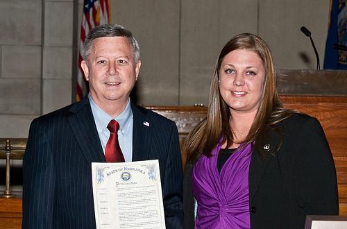 Nebraska Governor Dave Heineman declares April 20 to be Nebraska Stand for the Silent Day alongside RISE AmeriCorps member Heather Millard.