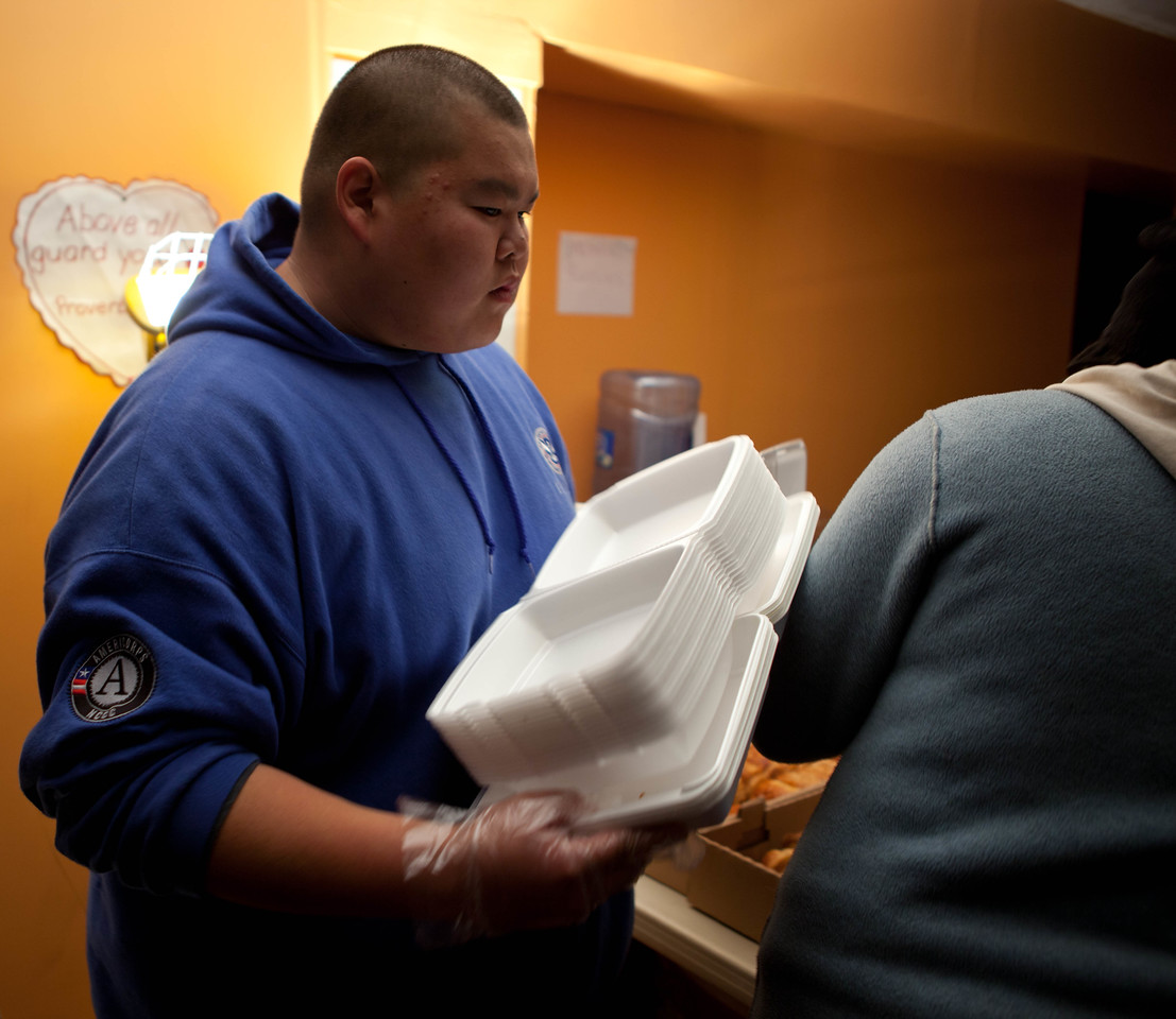 FEMA Corps member Thomas Sasamoto prepares to distribute hot meals to Hurricane Sandy survivors in Far Rockaway, NY. (Corporation for National and Community Service photo)