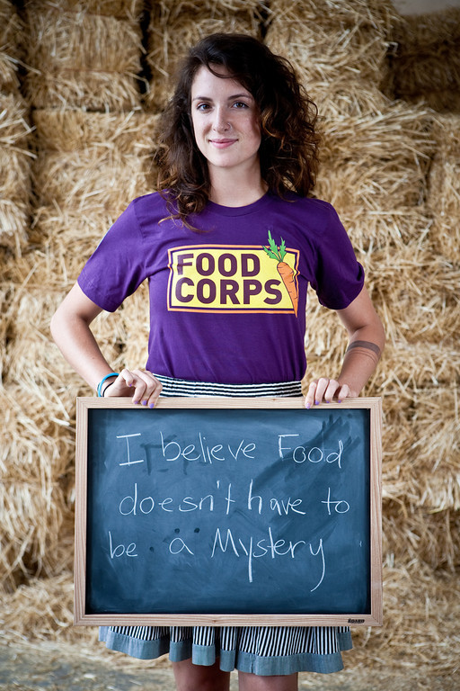 An AmeriCorps member with Food Corps displays a personal belief statement about why she became involved with Food Corps. (Photo by Whitney Kidder, PaperMoon Photography, 2011)