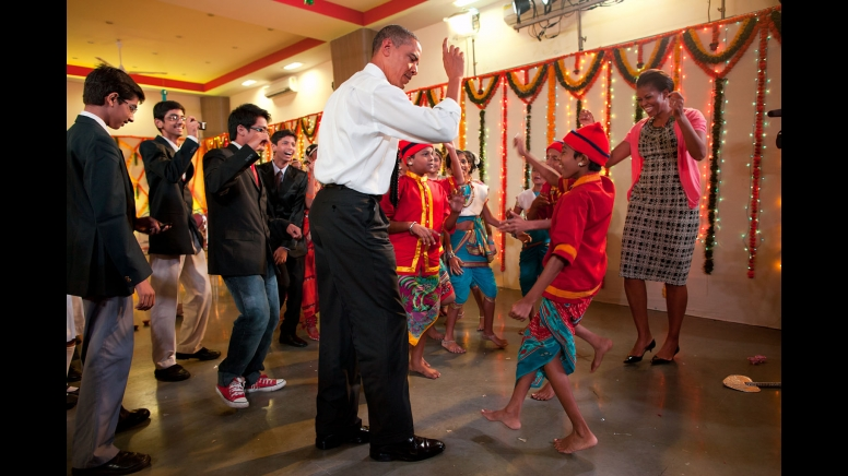 President Barack Obama and First Lady Michelle Obama dance with children at the Diwali candle lighting and performance at Holy Name High School in Mumbai, India, Nov. 7, 2010. (Official White House Photo by Pete Souza)