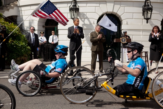 President Barack Obama, accompanied by Joint Chiefs Vice Chairman Gen. James Cartwright, center-right, and Assistant Veteran Affairs Secretary Tammy Duckworth, right, welcome the Wounded Warrior Project's Soldier Ride on the South Lawn of the White House, May 4, 2011. (Official White House Photo by Lawrence Jackson)