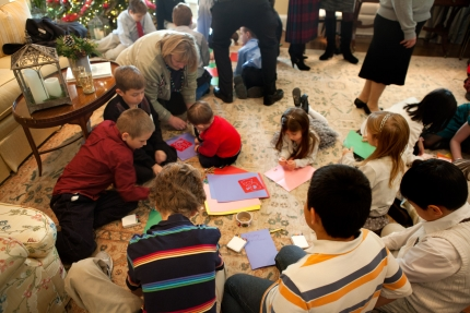 Through the American Red Cross' Holiday Mail for Heroes program, students write cards for military service members