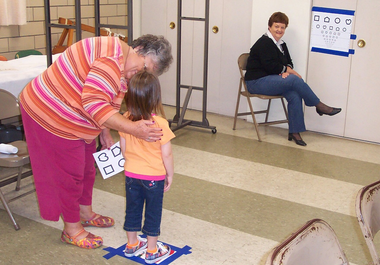RSVP volunteers of Daviess County Indiana perform vision screenings for preschool children.