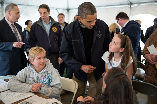 President Barack Obama talks with residents in a FEMA Disaster Recovery Center tent in Staten Island, NY, Nov. 15, 2012. Sen. Chuck Schumer and New York Governor Andrew Cuomo talk in the background. (Official White House Photo by Pete Souza)