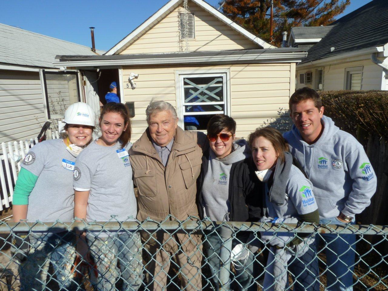 AmeriCorps members working with Habitat for Humanity pose with a homeowner in Staten Island, NY, who received repair assistance during the project. (Photo by Patricia Decker)