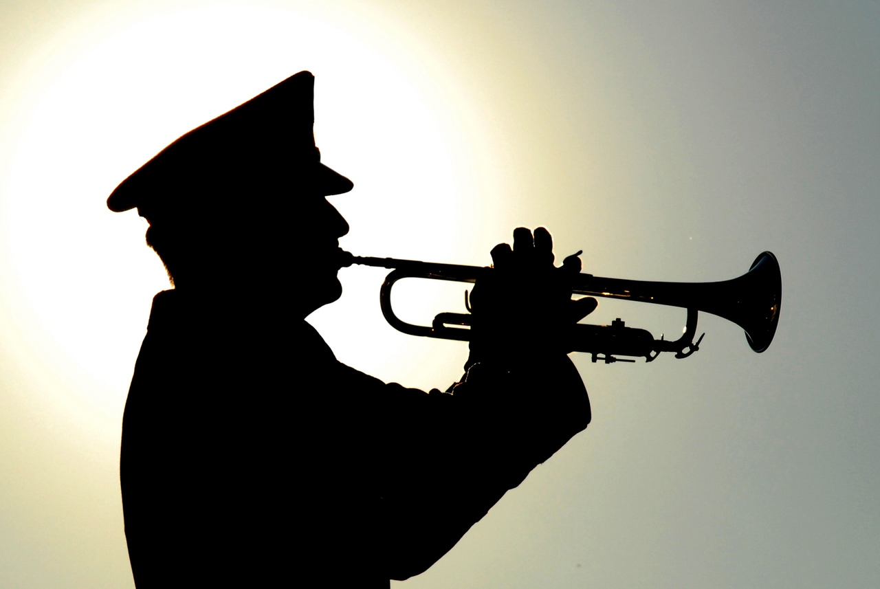 Staff Sgt. Adam Baker, Base Honor Guard, plays the bugle during a retreat ceremony November 9, 2007, at Little Rock Air Force Base, AR. The retreat ceremony, which symbolizes the end of the duty day, was held in celebration of the upcoming Veterans Day. (U.S. Air Force photo by SrA Chris Willis)