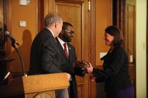 Director of AmeriCorps Bill Basl (left) and Jeffrey Richardson present the 2012 Mayor's Community Service Awards to DC Alums Chapter Leader Stephanie Vestal.