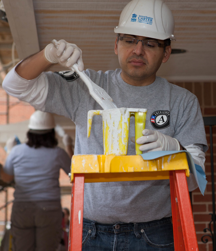 Robert Velasco, II, Acting CEO of the Corporation for National and Community Service paints part of a home during a service project organized by Habitat for Humanity of Washington, D.C., on March 16, 2012. (CNCS Photo)