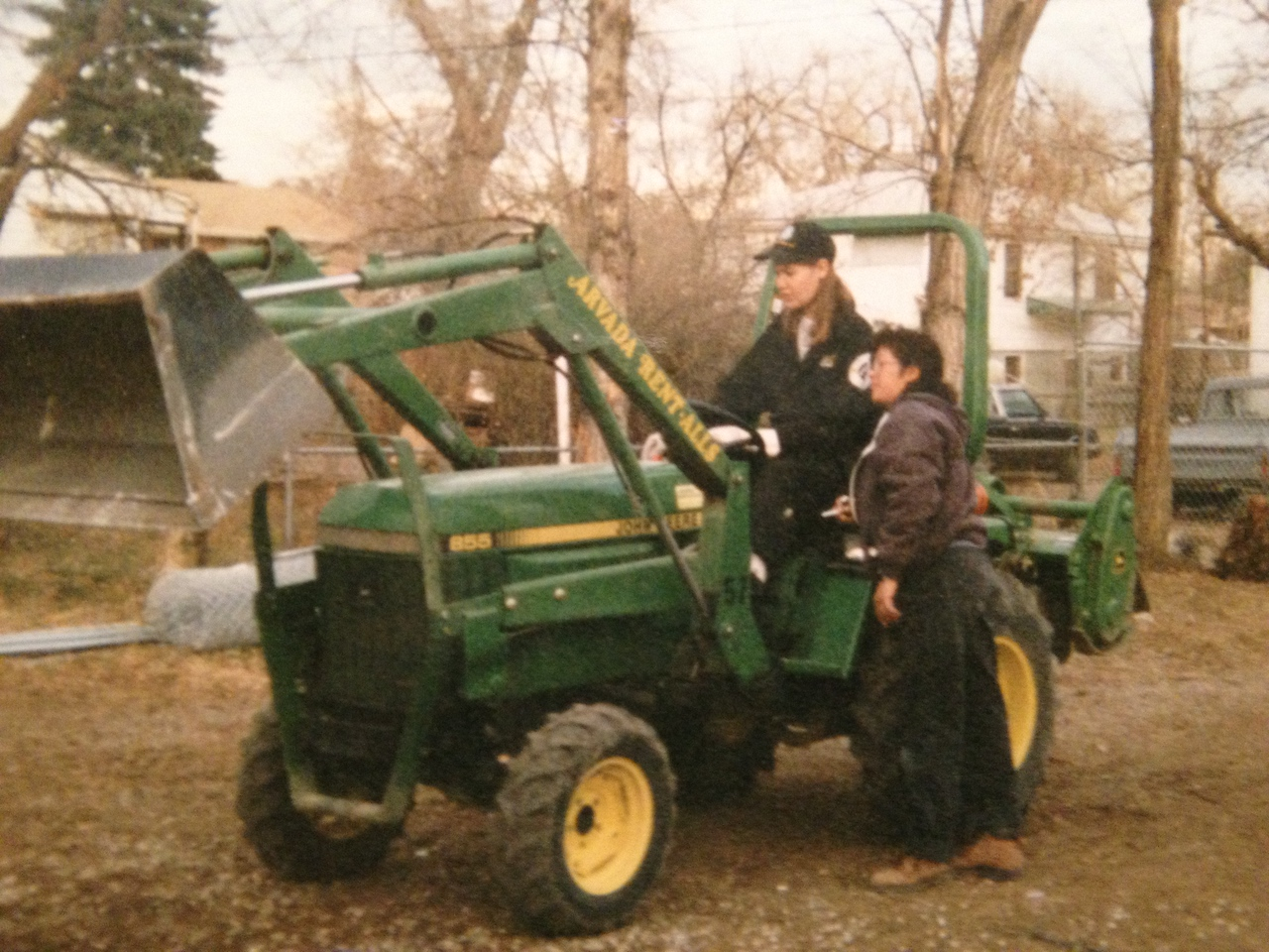 Rebecca Lange operates a tractor during her term of service with AmeriCorps NCCC from 1995-96.