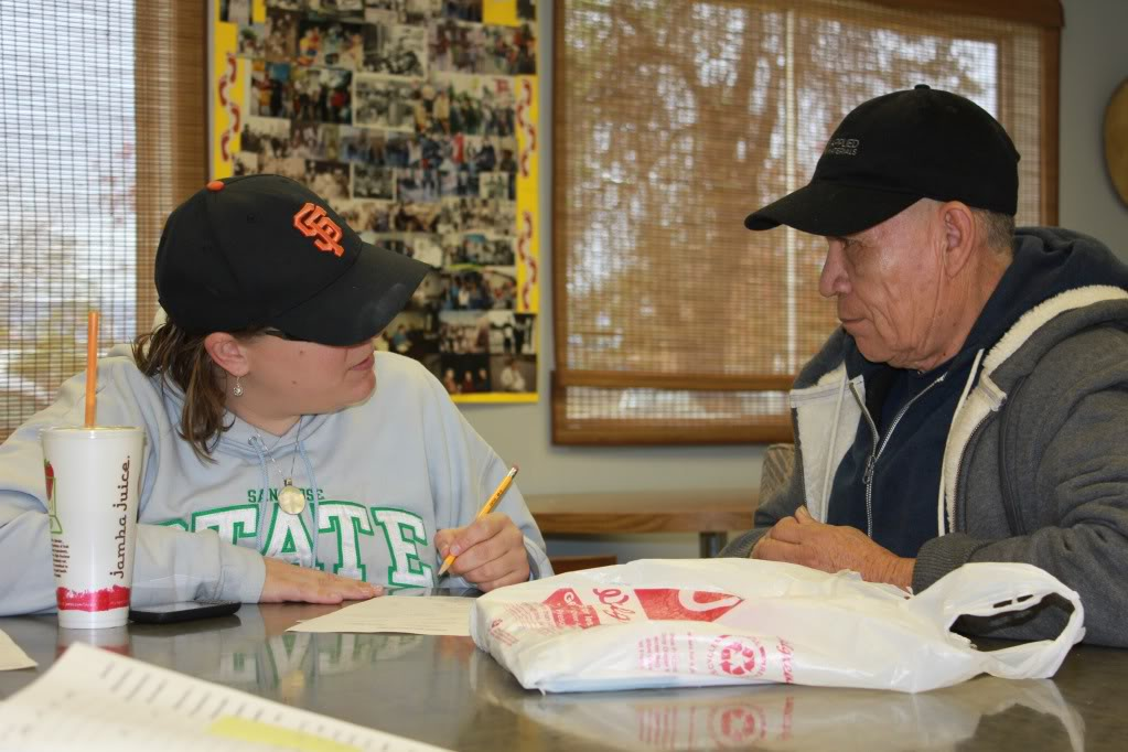 An AmeriCorps member works with a service recipient of the Building Skills Partnership, an AmeriCorps VISTA program at San Jose College in 2010. (Photo courtesy of Building Skills Partnership)