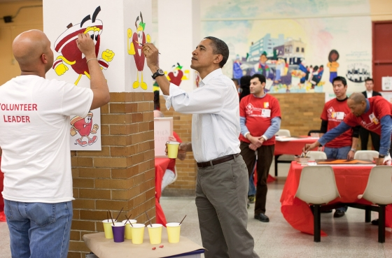 President Barack Obama helps paint pictures of fruit during a service project in the cafeteria of Stuart Hobson Middle School in Washington, DC, Jan. 17, 2011. (Official White House Photo by Pete Souza)