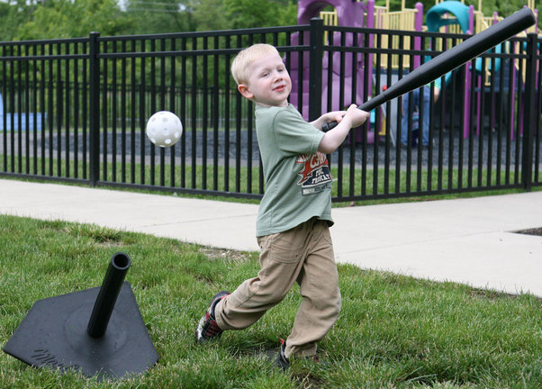 Andy Fass practices his baseball swing in a park.